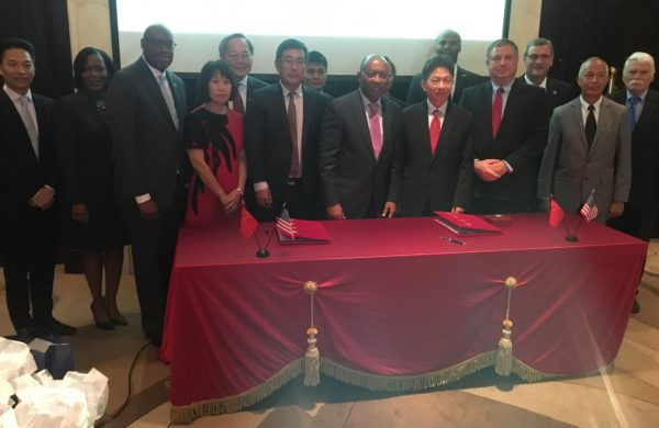 Photo includes Chinese and Houston business and government officials. From left to right: Marvalette Hunter, Chief of Staff, City of Houston; Council Member Larry Green; Mayor Sylvester Turner; Council Member Greg Travis; Greater Houston Partnership President and CEO, Bob Harvey; Mario Diaz, Director Houston Airport System; Andy Icken Director of Economic Development.